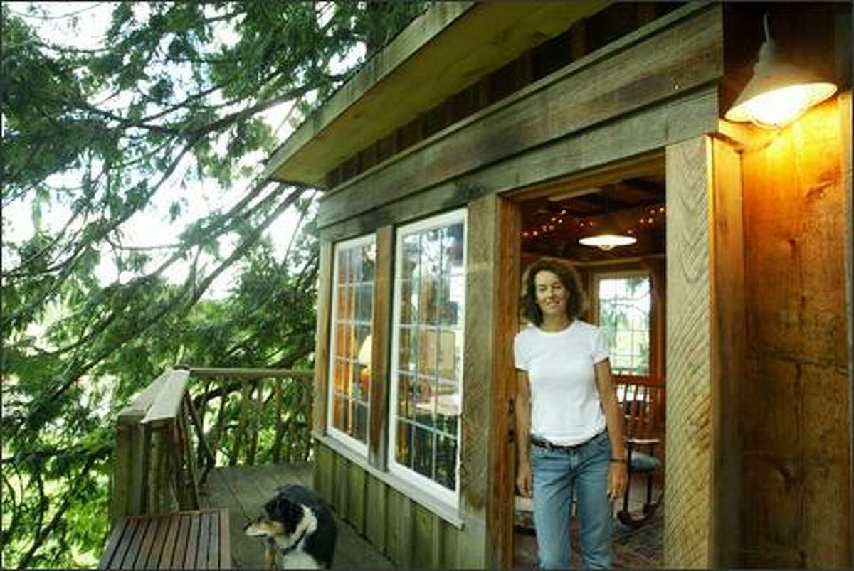 Lolly Shera's Fall City treehouse, which she uses as an art studio, has power, insulation, plug-in heat, alder paneling, stairs and a deck. It was built in 2002 as a project for TreeHouse Workshop students.