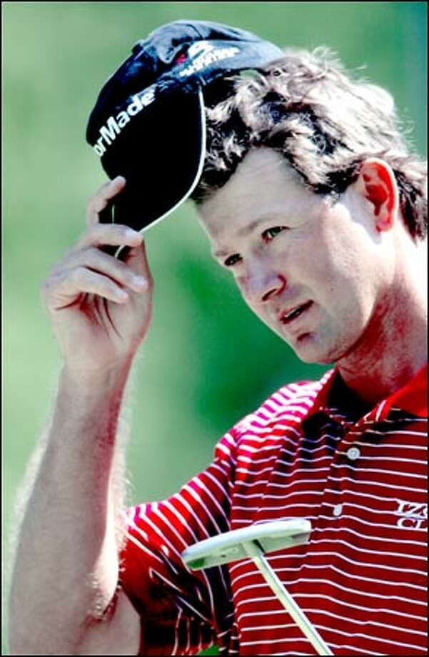 """Pro golfers are walking billboards for golf equipment, tournaments, investment firms and other golf-friendly companies around the world. Retief Goosen of South Africa is one of several contenders wearing """"Taylor Made"""" hats at the World Golf Championships-NEC Invitational at Sahalee this week. """"Precept"""" is another popular hat logo. Photo: Dan DeLong, Seattle Post-Intelligencer / Seattle Post-Intelligencer"""