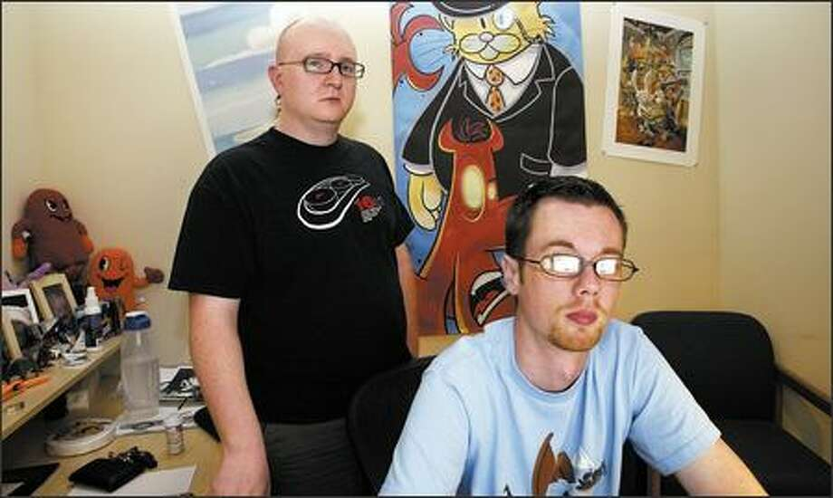 "The Penny Arcade Expo is an expansion of an online comic strip created by Jerry ""Tycho"" Holkins, left, and Mike ""Gabe"" Krahulik that is an irreverent take on gaming. Photo: Gilbert W. Arias, Seattle Post-Intelligencer / Seattle Post-Intelligencer"