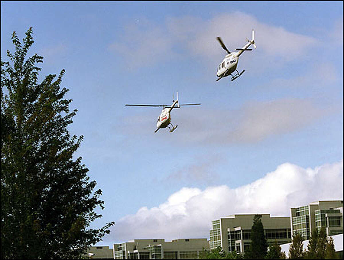 Helicopters leave Microsoft's campus for Boeing Field carrying representatives of six PC makers who just got final copies of Windows XP.
