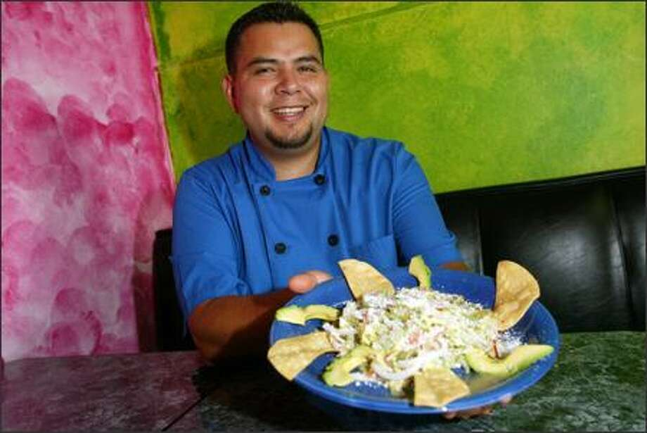 Juan Montiel wears many hats -- owner, chef, cashier and dishwasher-- at El Quetzal, the Beacon Hill restaurant he and his wife, Helena, run. The El Nopal cactus salad ($7.75) is one of 12 vegetarian dishes. Photo: Karen Ducey, Seattle Post-Intelligencer / Seattle Post-Intelligencer