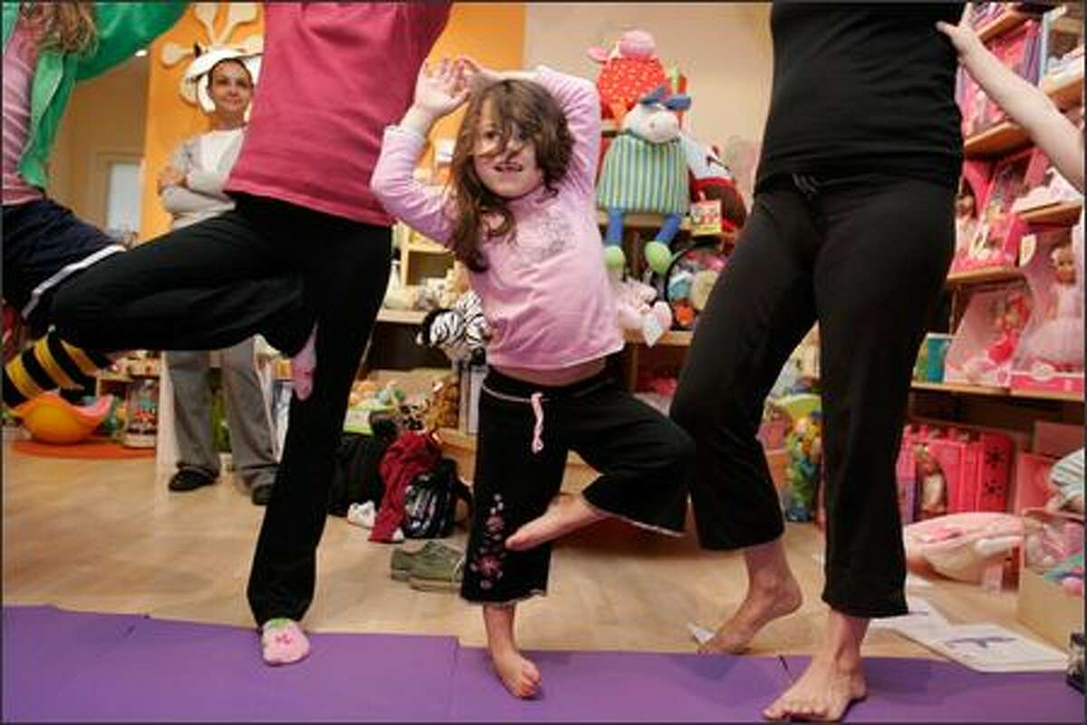 Eliana Sanchez, 4, tries a tree pose during an Itsy Bitsy Yoga class for kids ages 2 to 4 at Urban Kids Play on Queen Anne.