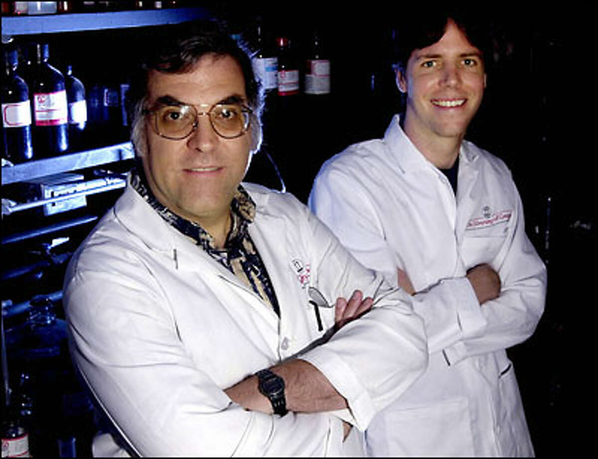 University of Georgia chemistry professor Robert Phillips, left, and graduate student Michael Cash stand in their lab in Athens, Ga., last month. Phillips and Cash won $30,000 for solving a chemistry problem on InnoCentive's Web site.