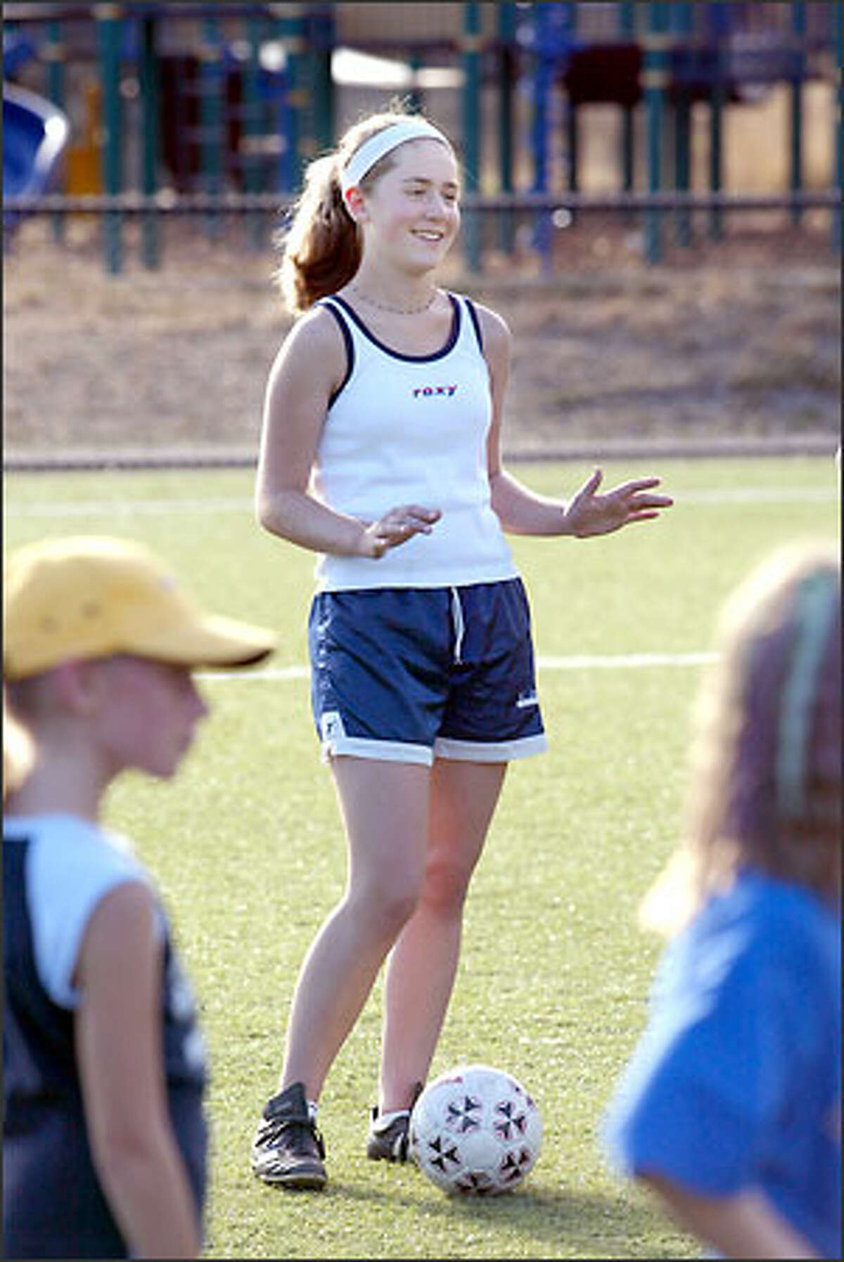 Emily Cranny, 14, who has an implanted defibrillator, can't play soccer, so she helps her dad coach.