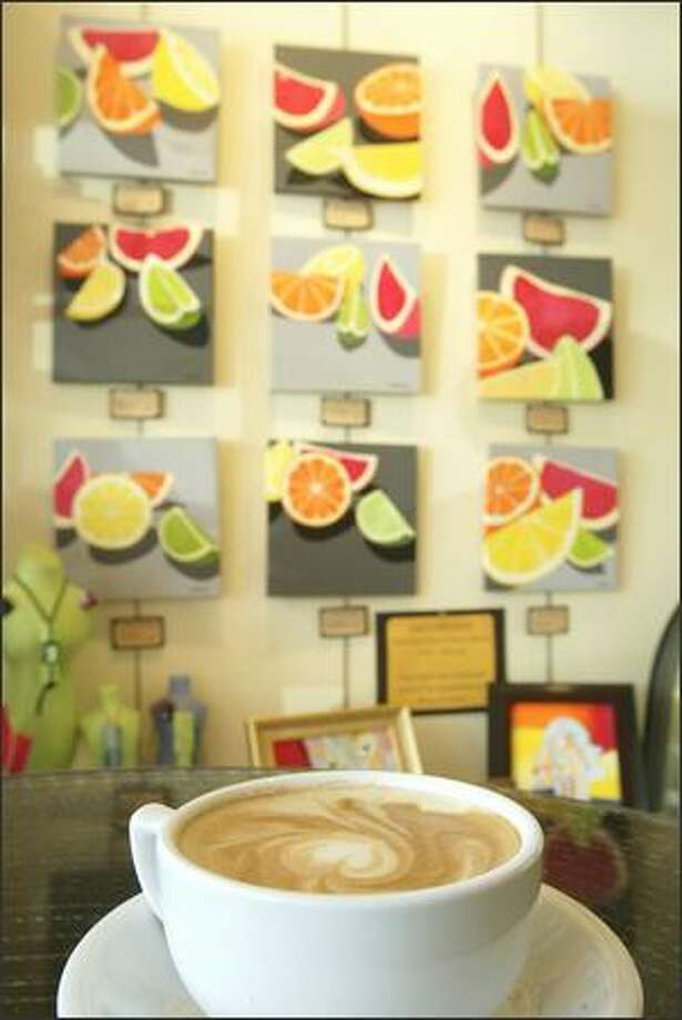 "Lynne Alexander's ""Citrus Series"" is among the fresh art perking up the scene at the Local Color coffeehouse at Pike Place Market. Photo: Mike Urban, Seattle Post-Intelligencer / Seattle Post-Intelligencer"