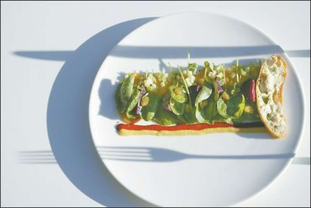 The beet and cress salad is impressive with its presentation, laid out in rectangular artistry of discs and crescents and leaves set against a simple white plate.