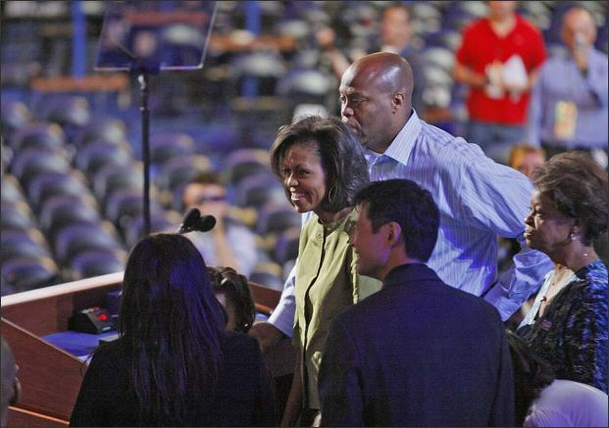 Michelle Obama, wife of Democratic presidential candidate, Sen. Barack Obama, D-Ill., tours the stage and podium at the Democratic National Convention in Denver on Monday. Michelle Obama is scheduled to speak to the gathering Monday night.