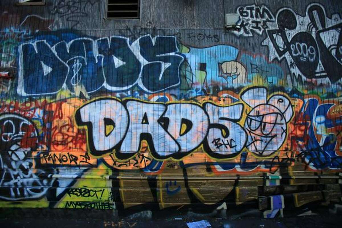 The now-defunct Tubs building is covered with with graffiti.