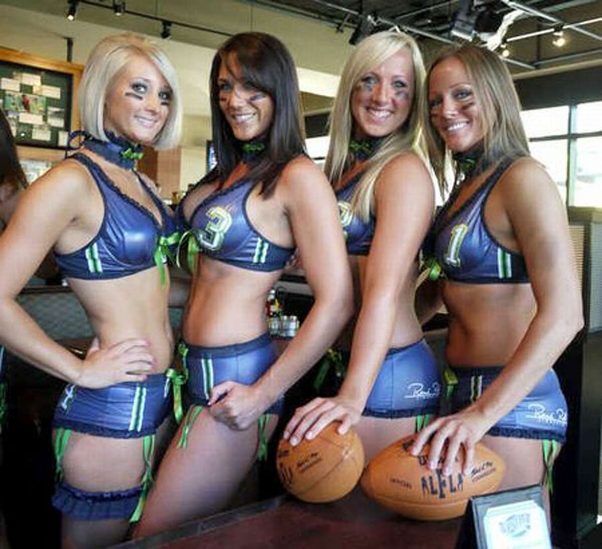 Seattle Mist players pose for photos during the team's media day at Sport Restaurant in Seattle on Wednesday.