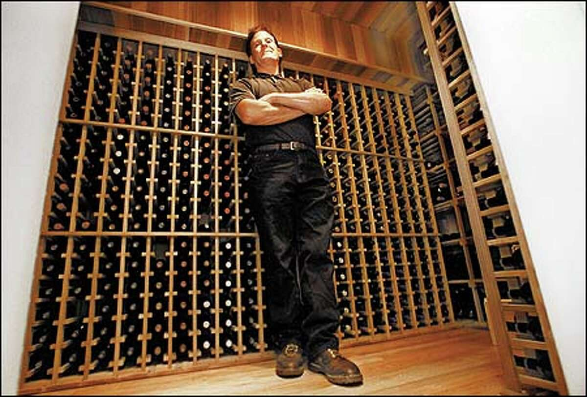 Kevin Pettit of Vintage Solutions stands in a custom wine cellar he built in a Magnolia home. A spare room or closet will do for a cellar conversion.