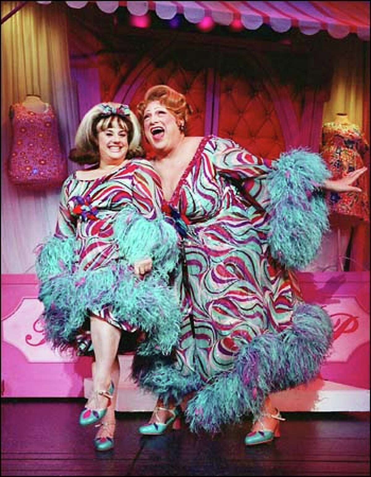 Plump Tracy Turnblad (Marissa Janet Winokur) shares a light moment with her well-padded mother Edna right, (Harvey Fierstin), in a scene from