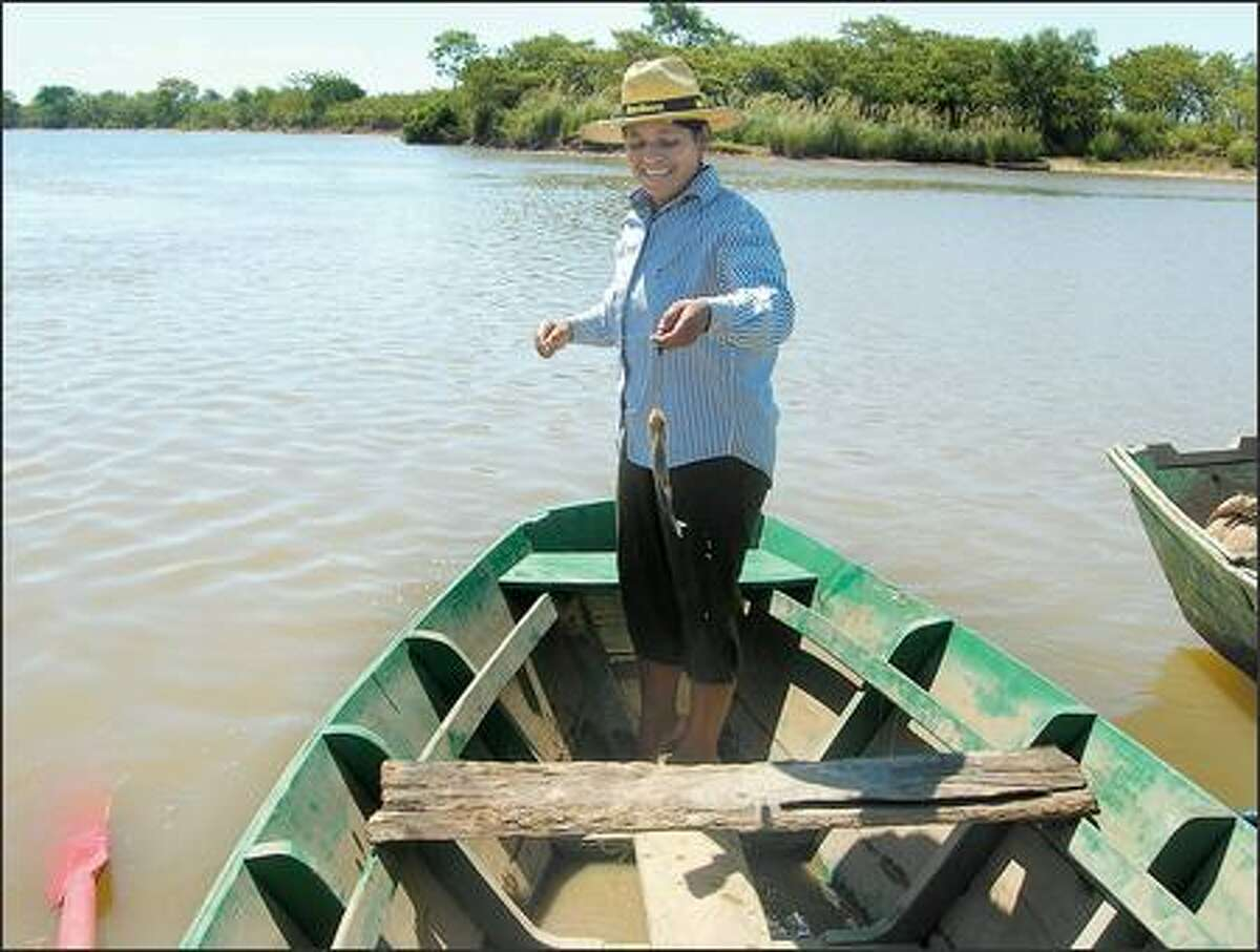 A mother from one of the host families catches a fish near the town of General Jose Diaz.