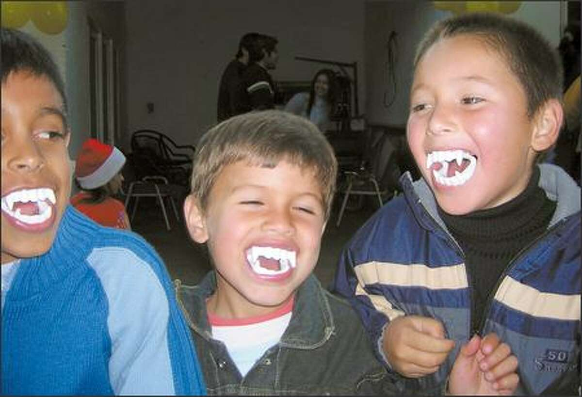 Three brothers, from one of the host families in the same area, smile for the camera.
