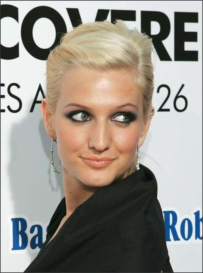 "She's gone platinum blond like big sis Jessica, but will that jump-start Ashlee Simpson's flagging career? Papa/manager Joe Simpson has rebooked Ashlee on ""Saturday Night Live"" -- to make fun of herself and actually sing, rather than mouth lyrics, this time. But first, he said she'll sing for and talk with Oprah this fall. Simpson appears here at the Tuesday premiere of ""Undisco-vered."" Photo: Associated Press / Associated Press"