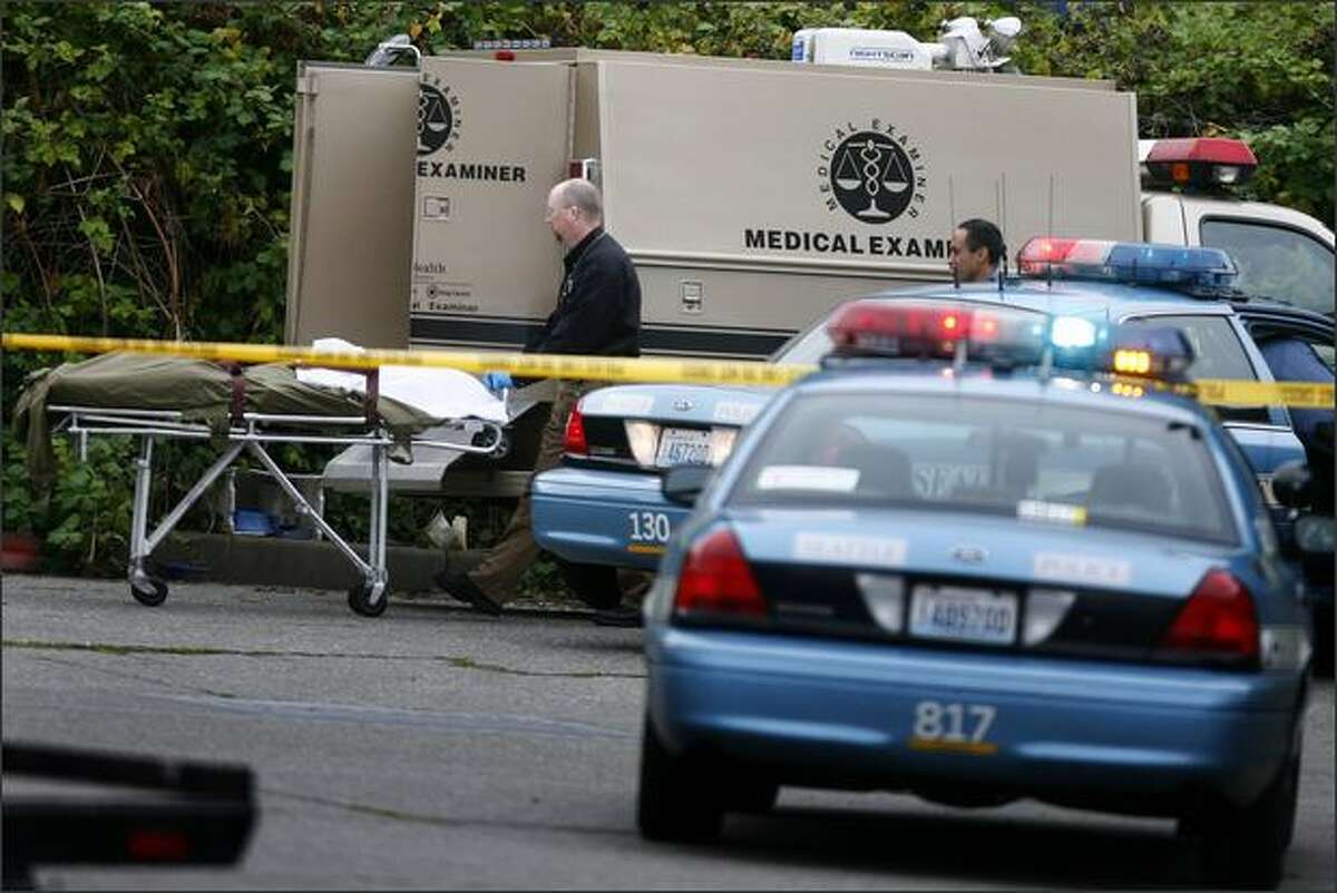 King County Medical Examiners remove a body near the intersection of Ninth Avenue South and South Dakota Street on Thursday morning.
