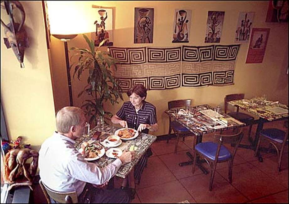 Margaret Hopstein and Charles V. Neals enjoy an early dinner at Afrikando, a restraunt specializing in West African fare. Photo: Grant M. Haller, Seattle Post-Intelligencer / Seattle Post-Intelligencer