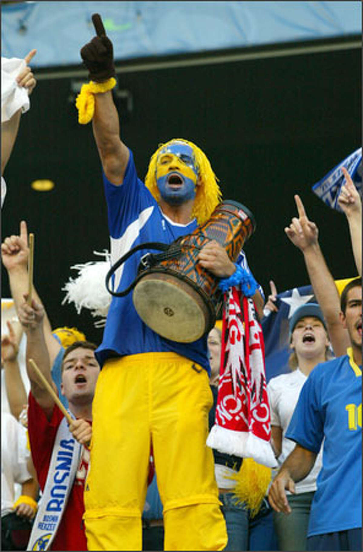 Samedin Duldanic cheers on Bosnia in the All Nations Cup final against Brazil at Seattle's Qwest Field. Fans came with drums, tambourines, cowbells and other noisemakers yesterday to cheer on teams.