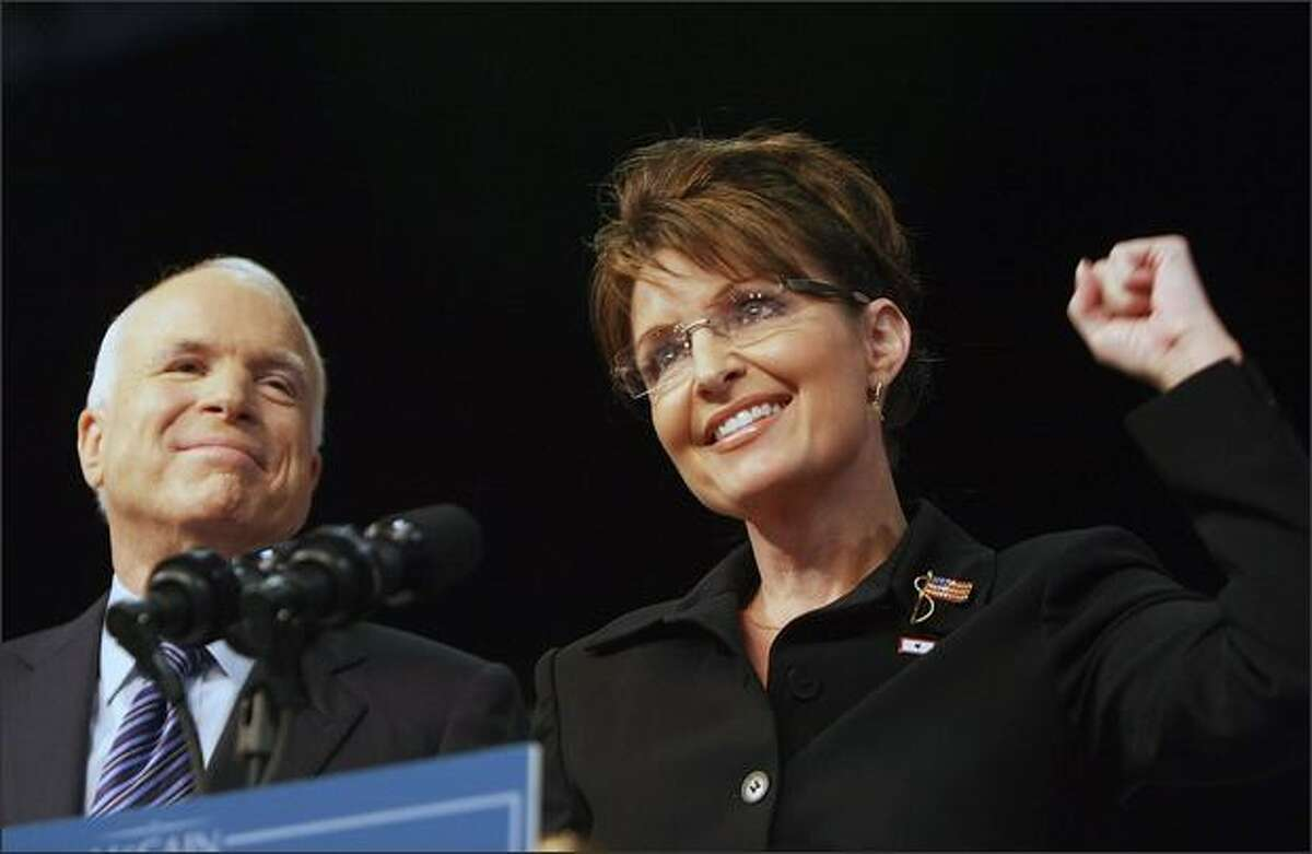 Republican presidential candidate John McCain, R-Ariz., stands with new vice presidential candidate Alaska Gov. Sarah Palin in Dayton, Ohio.