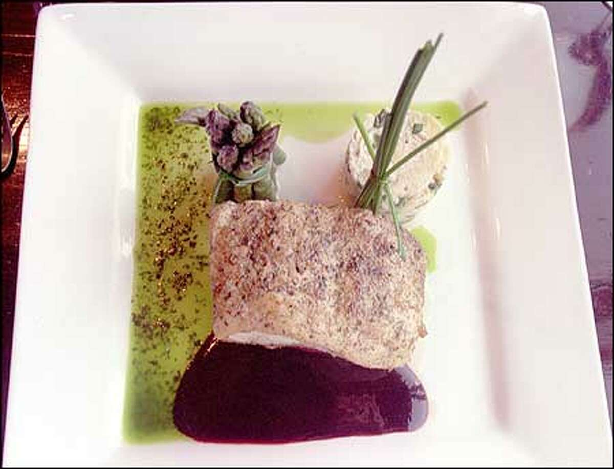 """Blue Onion's described as """"a place you could take your mom and still have fun."""" Served above: herb crusted Alaskan halibut, dill potatoes, asparagus and heirloom tomato."""