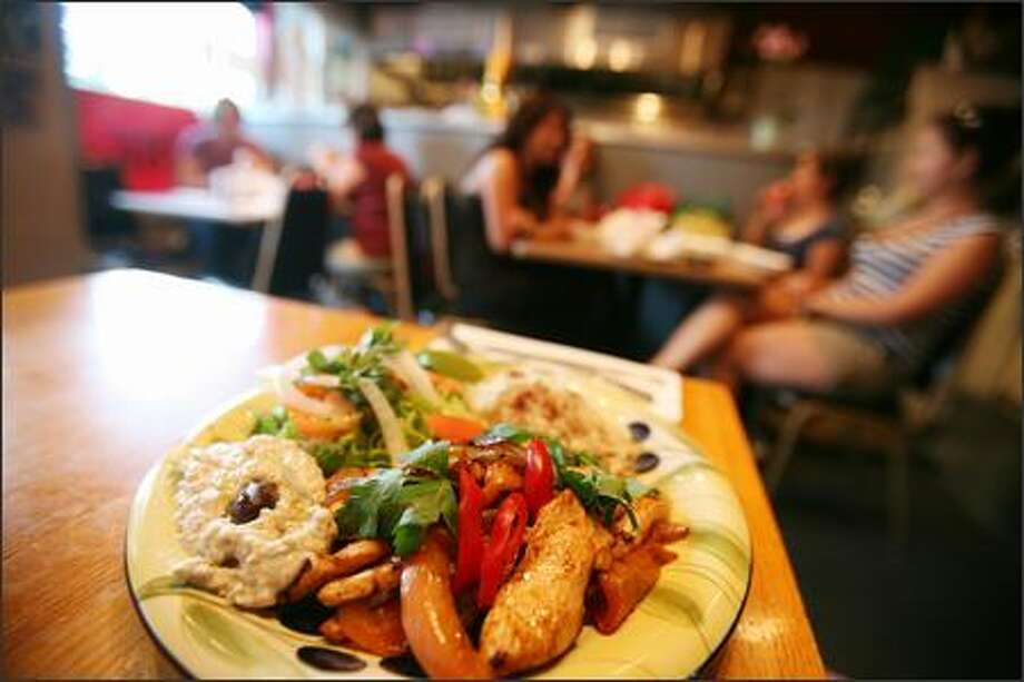 King Falafel Grill's delicious chicken shawarma plate, served with hummus, is a great contrast of flavors and a considerable bargain at only $6. Photo: Paul Joseph Brown, Seattle Post-Intelligencer / Seattle Post-Intelligencer