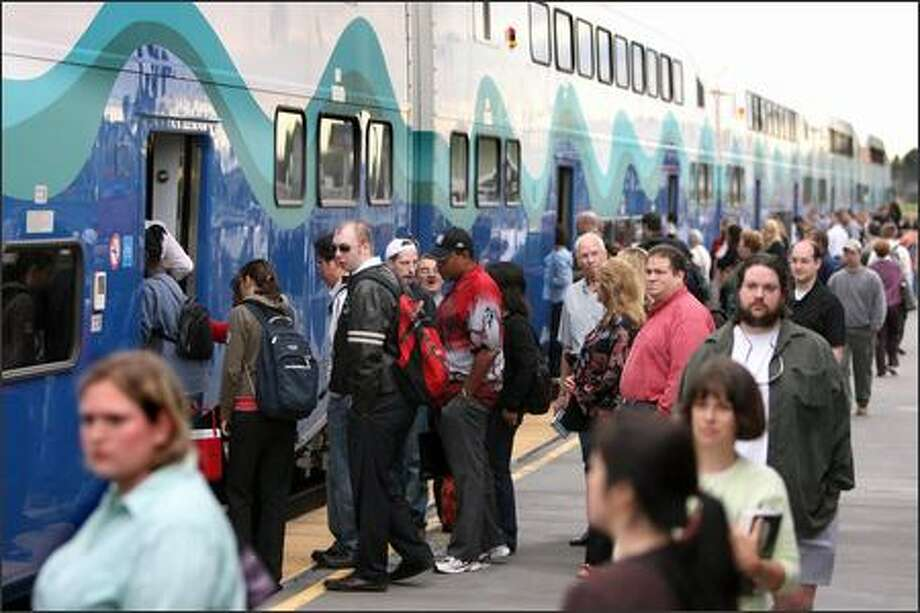 In this file photo, riders board the northbound Sounder train at Kent Station, with the final stop at King Street Station in Seattle. Photo: Scott Eklund, Seattle Post-Intelligencer / Seattle Post-Intelligencer
