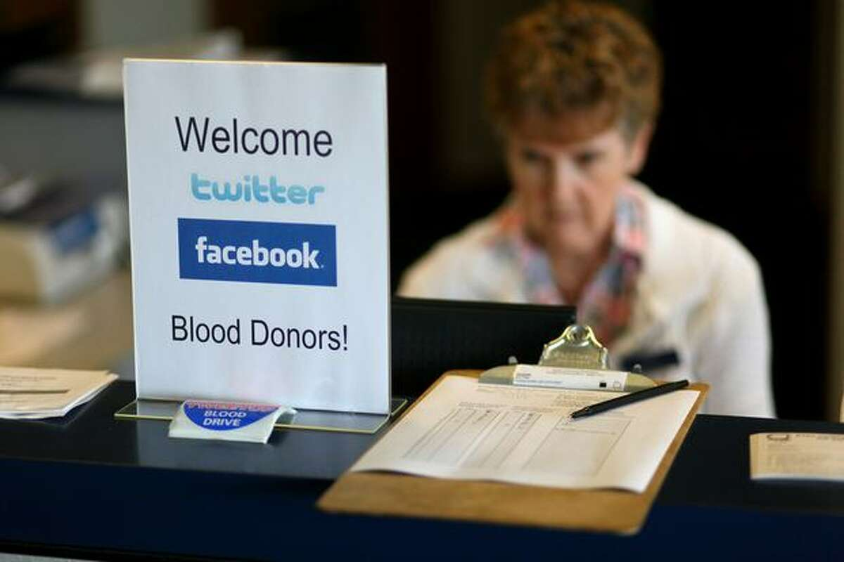 A sign welcomes blood donors to the Puget Sound Blood Center on Thursday in Bellevue. Donors are being recruited via social media sites as part of a new method to bring people into the center.
