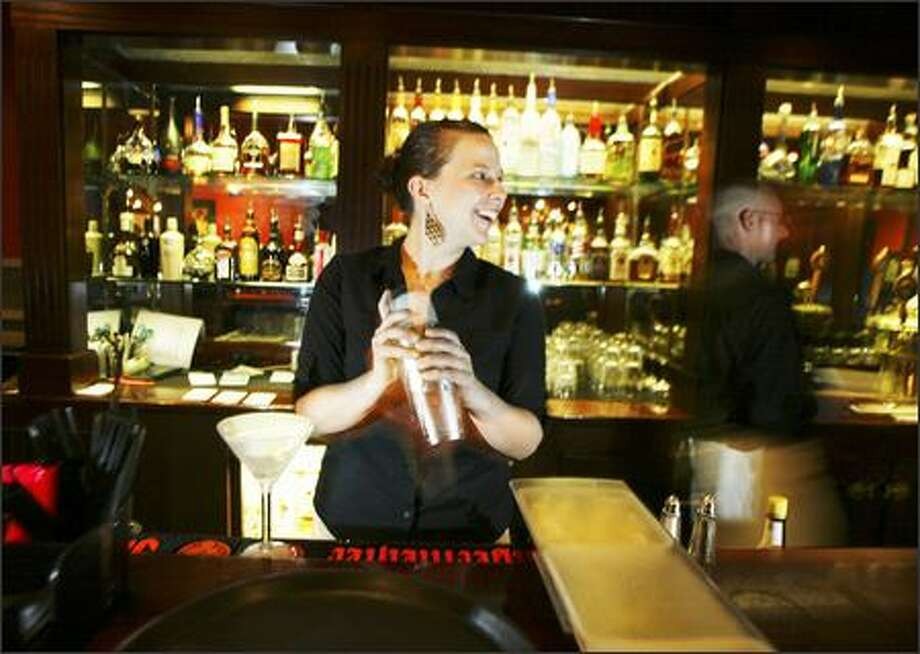 Bartender Sara Kath shakes, not stirs, a gin martini at the District Lounge. The bar is hidden away in the University Tower Hotel. Photo: Jim Bryant, Seattle Post-Intelligencer / Seattle Post-Intelligencer