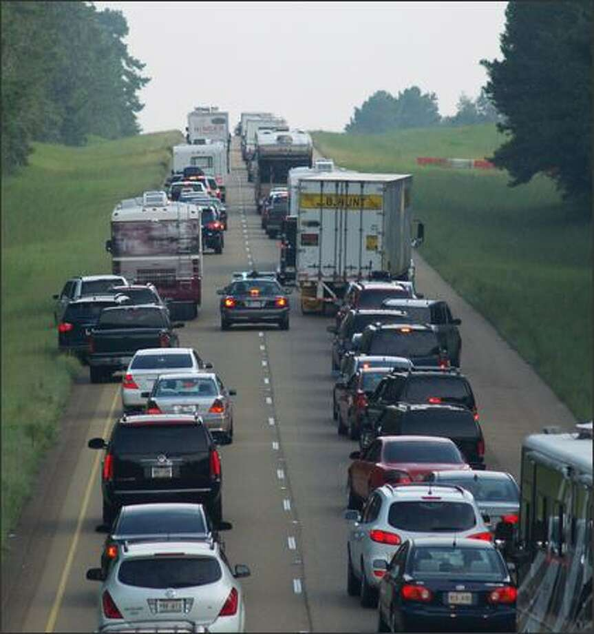 A Mississippi Highway Patrol vehicle attempts to make its way through northbound traffic on U.S. 55 Sunday as evacuees line the interstate on their way out of the path of Hurricane Gustav on Sunday. Both the north and southbound lanes of U.S. 55 and U.S. 59 were contraflowed at 4 a.m. Sunday in order to allow for a more speedy evacuation for residents of Louisiana and the Mississippi Gulf Coast areas. Photo: Associated Press / Associated Press