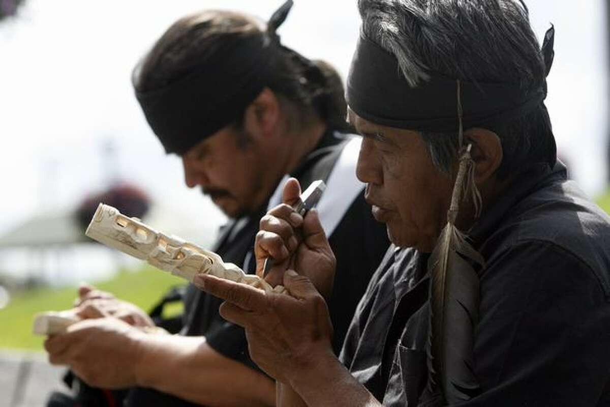 Rick Williams, right, said his brother John T. Williams, who was killed in a confrontation with a Seattle police officer Monday, lost hearing in his left ear eight years ago. John Williams was part of the Nitinaht Tribe. His nephew, Paul Williams, left, said he's an eighth-generation carver.