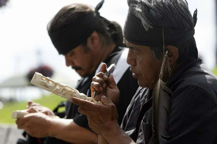 Rick Williams, right, said his brother John T. Williams, who was killed in a confrontation with a Seattle police officer Monday, lost hearing in his left ear eight years ago. John Williams was part of the Nitinaht Tribe. His nephew, Paul Williams, left, said he's an eighth-generation carver. Photo: Casey McNerthney, Seattlepi.com / seattlepi.com