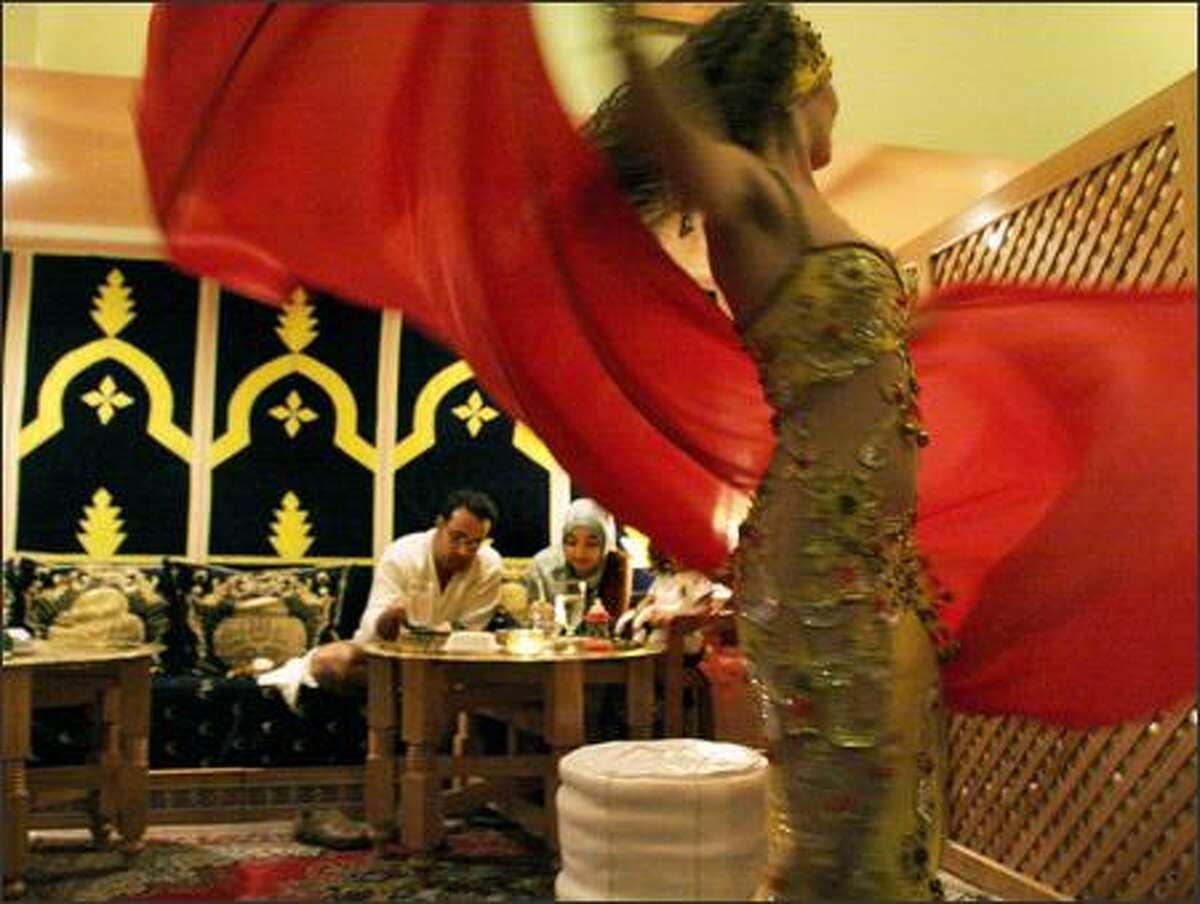 Belly dancers (Lisa Mandin, above) perform Friday and Saturday nights at 7:30 and 8:30 at Kasbah.