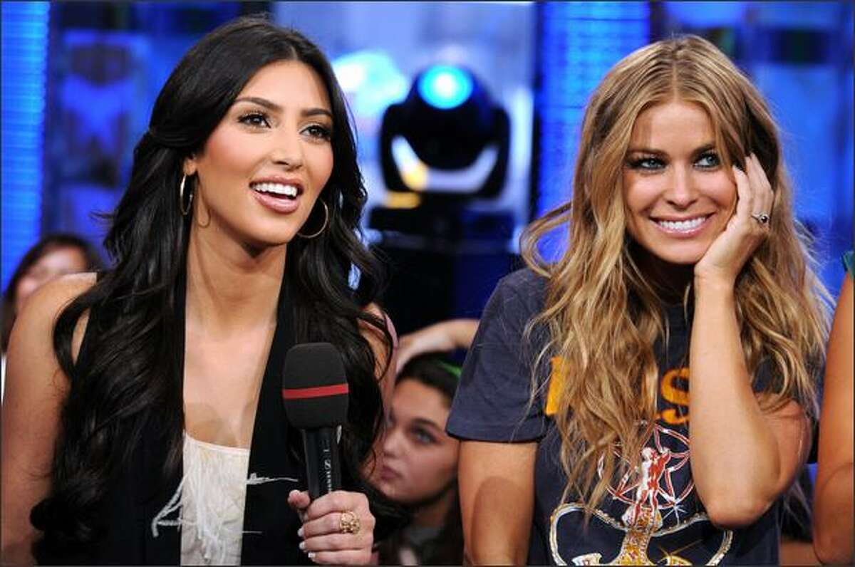 """Kim Kardashian, left, and Carmen Electra have experienced the highs and lows of reality TV series. They turned their talents to the spoof flick """"Disaster Movie,"""" which opened Friday. The movie has a scene in which the actresses' characters stage a WWE-like brawl, but just like in """"real"""" wrestling, it was staged."""