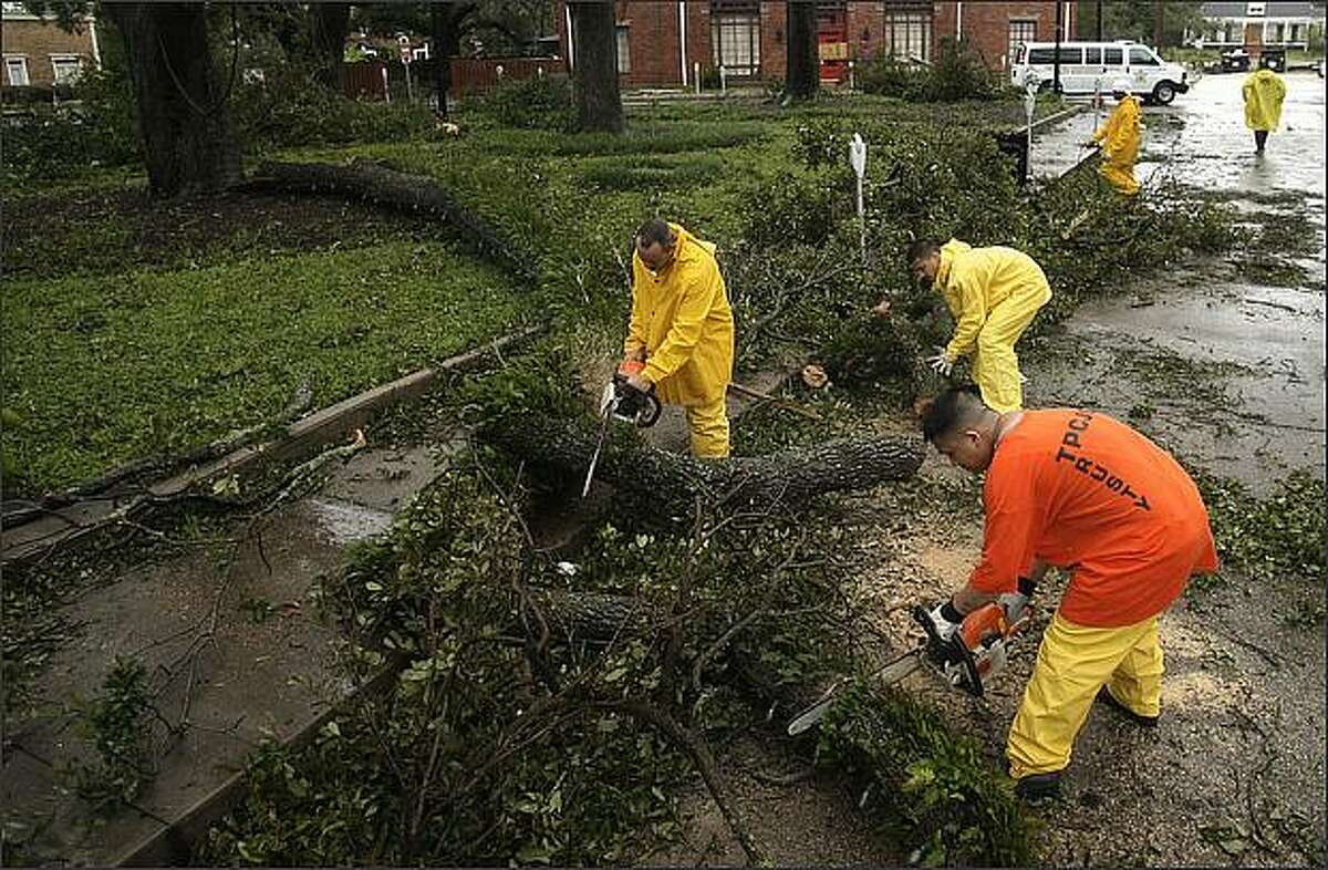 Workers clean up debris left by Hurricane Gustav Monday in Houma, La. A weaker-than-expected Hurricane Gustav swirled into the fishing villages and oil-and-gas towns of Louisiana's Cajun country Monday, delivering only a glancing blow to New Orleans.