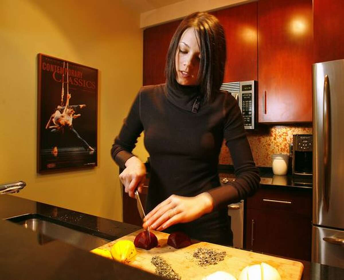 Kari Brunson prepares dinner at her home in Seattle in this February 2008 file photo.
