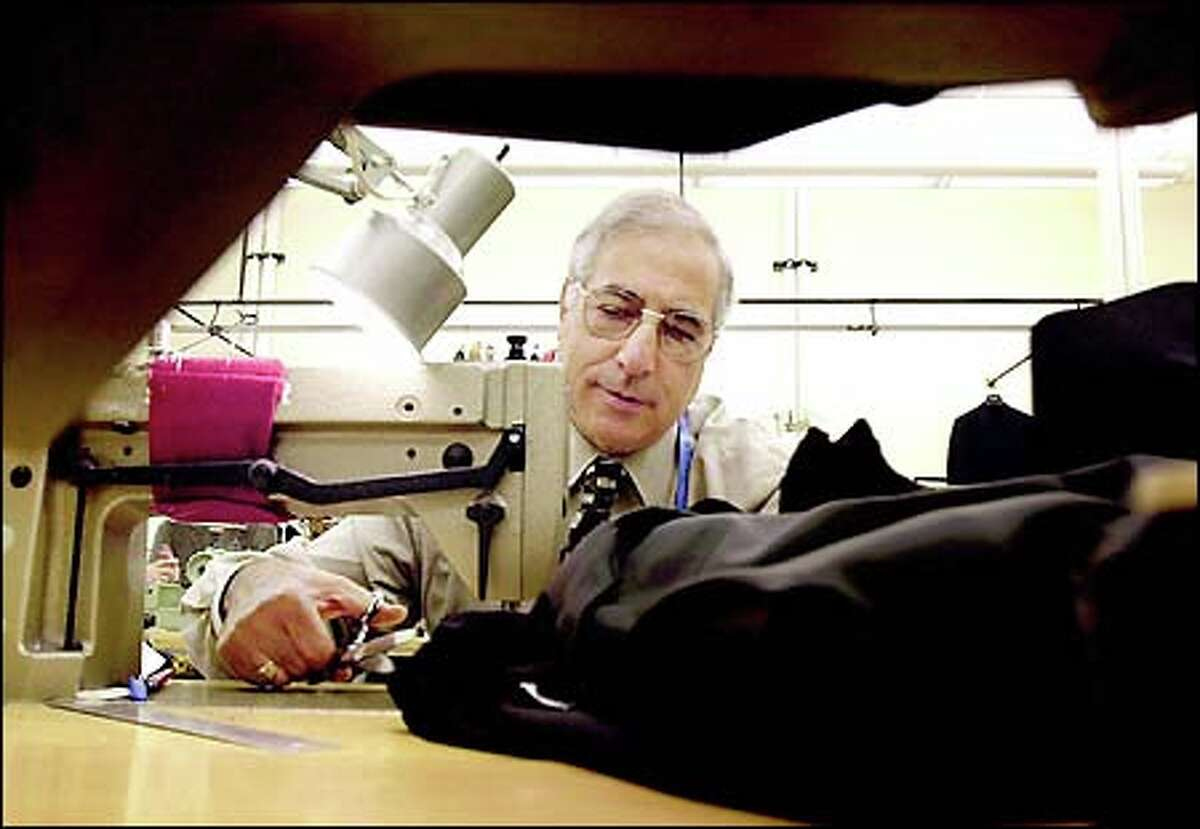 Head tailor Mario Marchese of Mark Shale Clothes in Chicago at work.