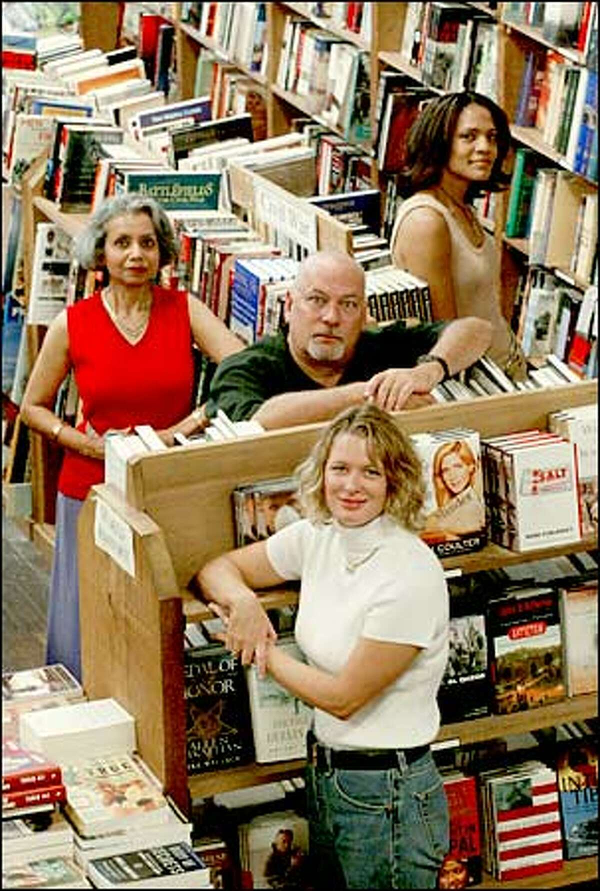 Rising local talents Bharti Kirchner, left, G.M. Ford, center, Kristin Hannah, front, and Trisha Thomas at The Elliott Bay Book Co.