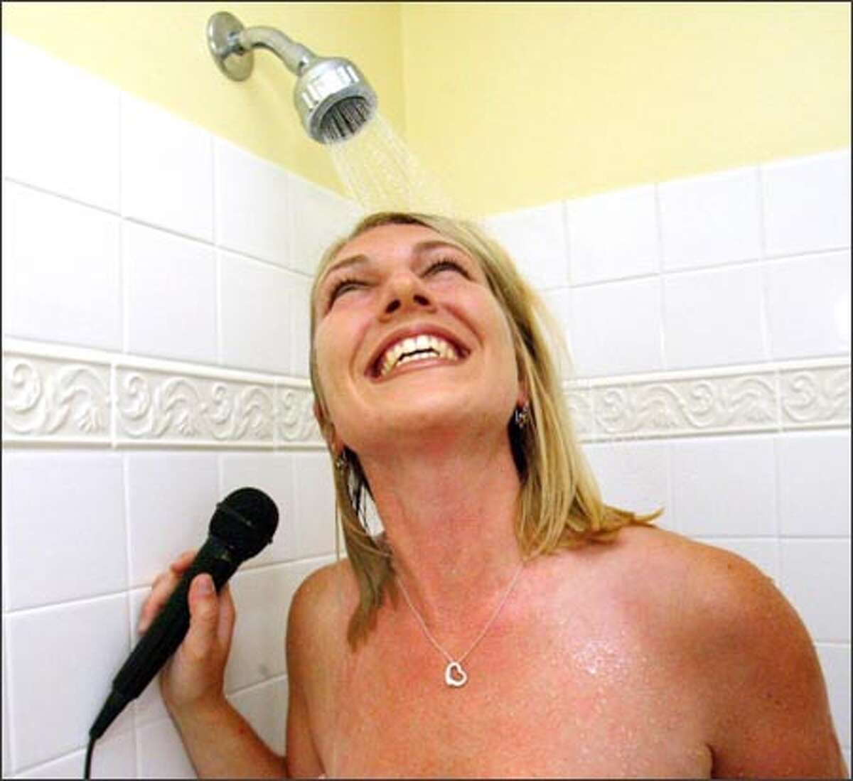 Julie Gatz, winner of the American Standard company's shower-singing contest, practices