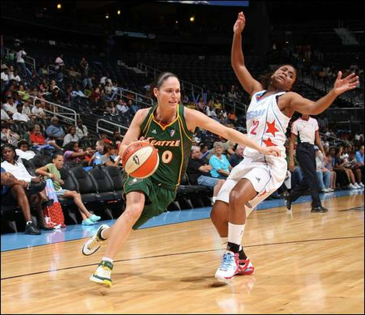 Sue Bird, driving past Ivory Latta, scored 21 points and had nine assists.