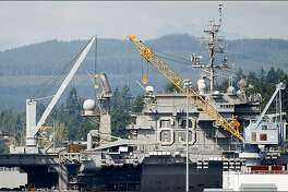 The USS Kitty Hawk, the Navy's last diesel-powered aircraft carrier, arrived Tuesday at the Puget Sound Naval Shipyard in Bremerton, where it will be decommissioned.