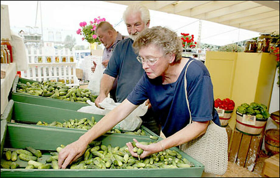 "Betty and Don Young, of Gig Harbor, have been buying pickling supplies at the Duris Cucumber Farm for almost a half-century. ""I used to shop here with my mother,"" Betty recalled. Photo: Mike Urban, Seattle Post-Intelligencer / Seattle Post-Intelligencer"