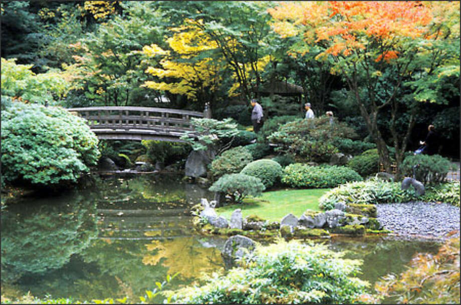 Portland's Japanese Garden can be an inspiring place to stroll through when contemplating the joys of fall's palette. Japanese maples can be purchased in full color in local nurseries in November. Photo: Marty Wingate, For The Seattle Post-Intelligencer / for the Seattle Post-Intelligencer