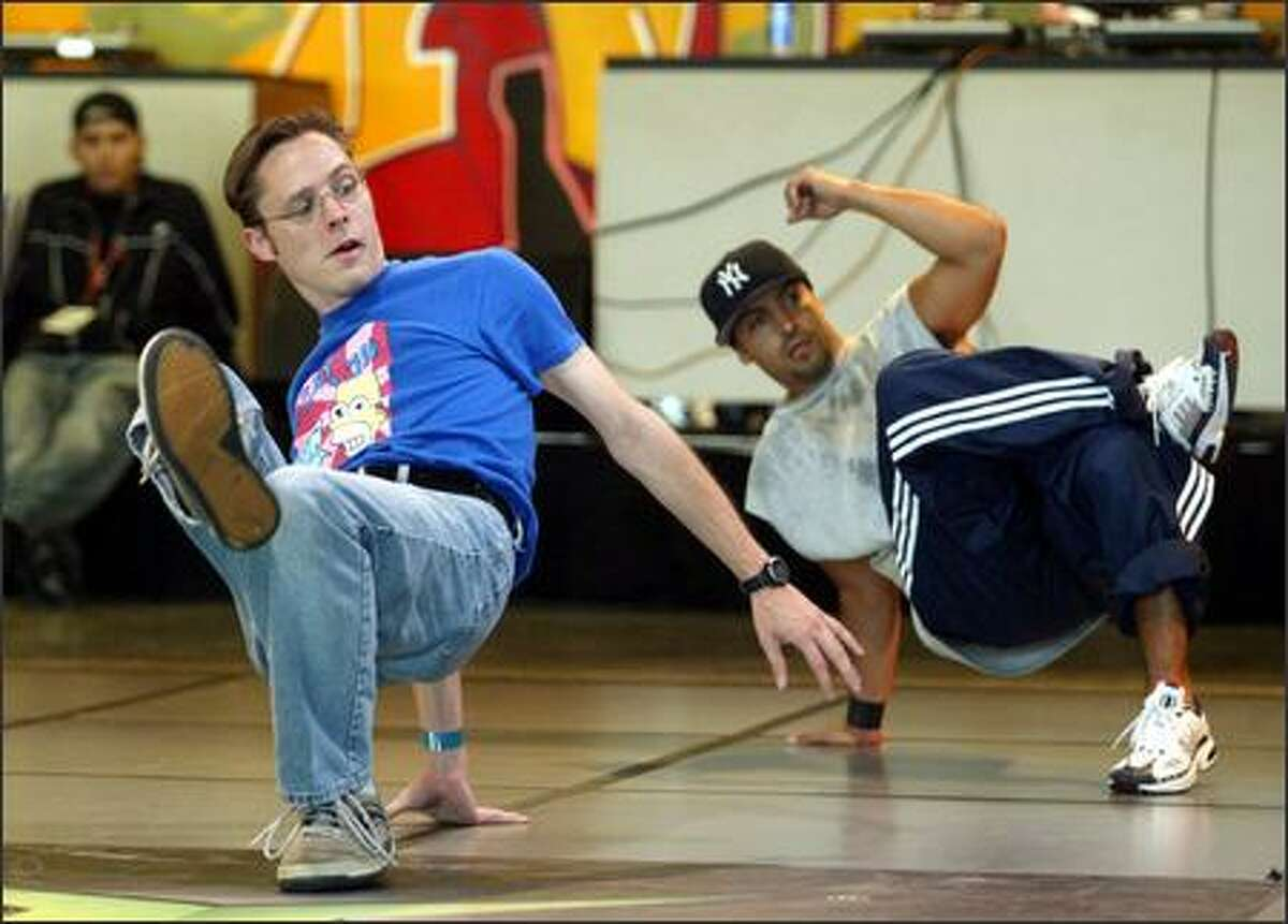 Scott Moran of Seattle (left) was one of the partipants in the B-Boy fundamentals workshop taught by Ken Swift (right) of New York City at Bumbershoot's CenterCircleSpin.