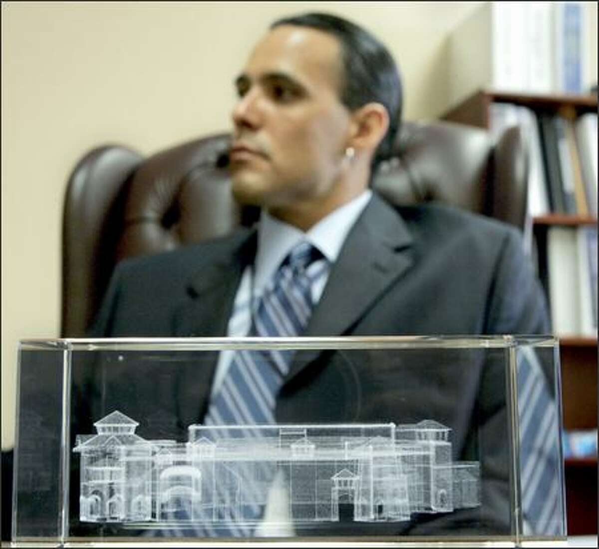 San Manuel Vice Chairman Vincent Duro sits behind a glass etching depicting the San Manuel casino.
