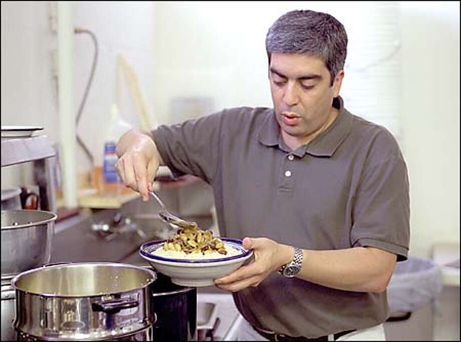 "Mustapha Haddouch, owner of Haddouch Gourmet Imports, says, ""The difference between fresh couscous and instant is the difference between fresh pasta and dry pasta."" Photo: Gilbert W. Arias, Seattle Post-Intelligencer / Seattle Post-Intelligencer"