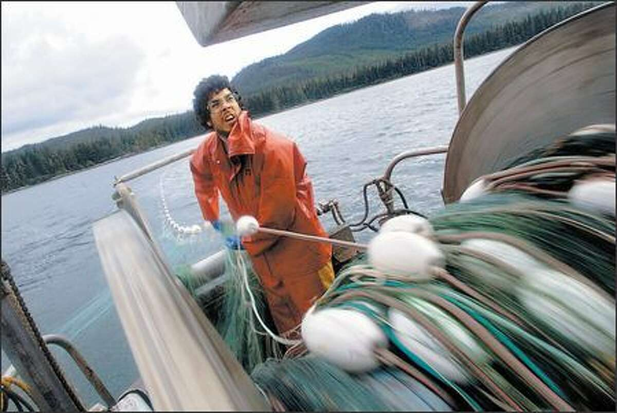 Jonah Knutson lays out his net near Coffman Cove, Alaska, while keeping an eye on a transmission indicator that tells him when the boat is accidentally slipping into gear.