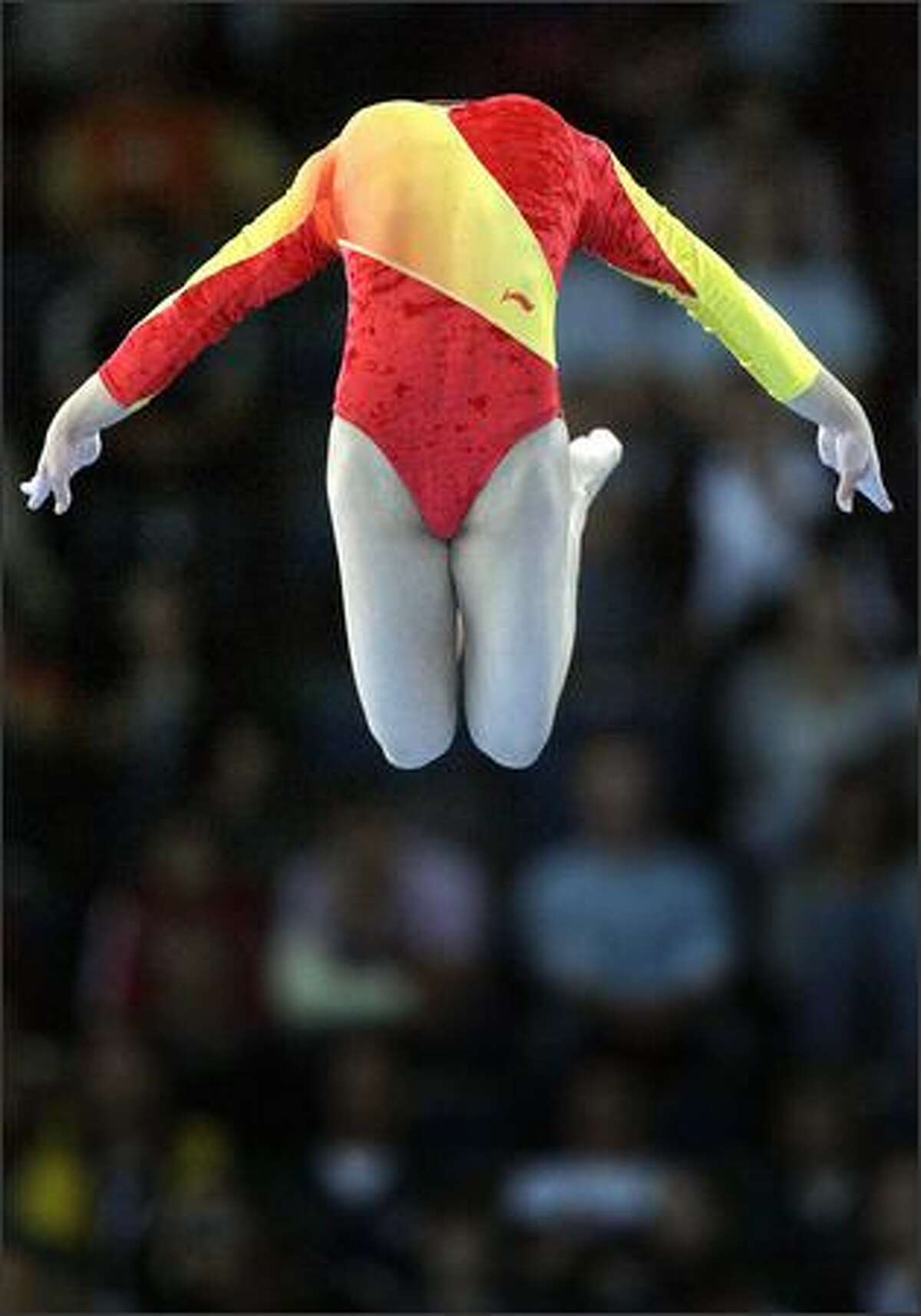 China's Fei Cheng competes on the beam during the women's team final of the Gymnastics World Championships in Stuttgart, southern Germany. (AP Photo/Michael Sohn)