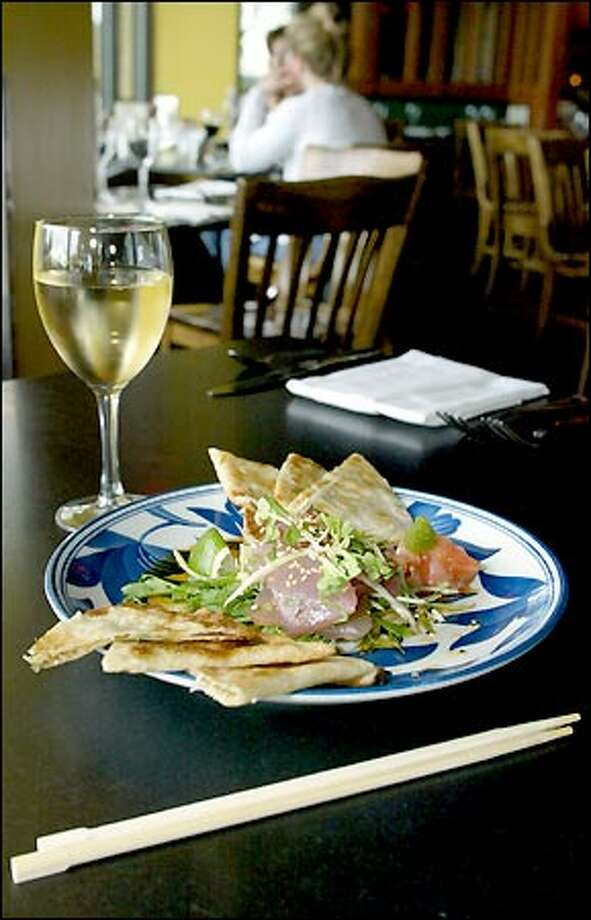 One of the better bets at Etta's Seafood is owner Tom Douglas' tasty signature dish of tuna sashimi salad and green onion pancakes ($12). Photo: Gilbert W. Arias, Seattle Post-Intelligencer / Seattle Post-Intelligencer