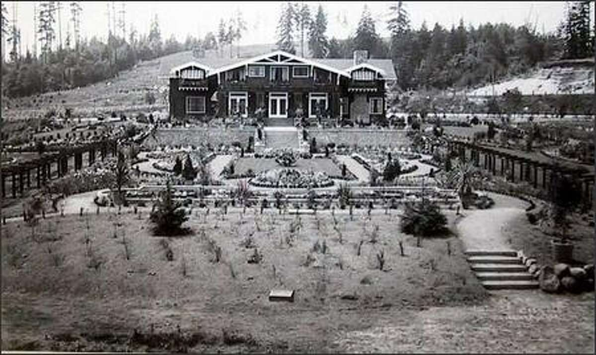This view of the manor house and gardens was taken July 9, 1913. Owner Frederick Stimson called the estate Hollywood Farm after the hundreds of holly trees he planted. (Courtesy of Chateau Ste. Michelle)