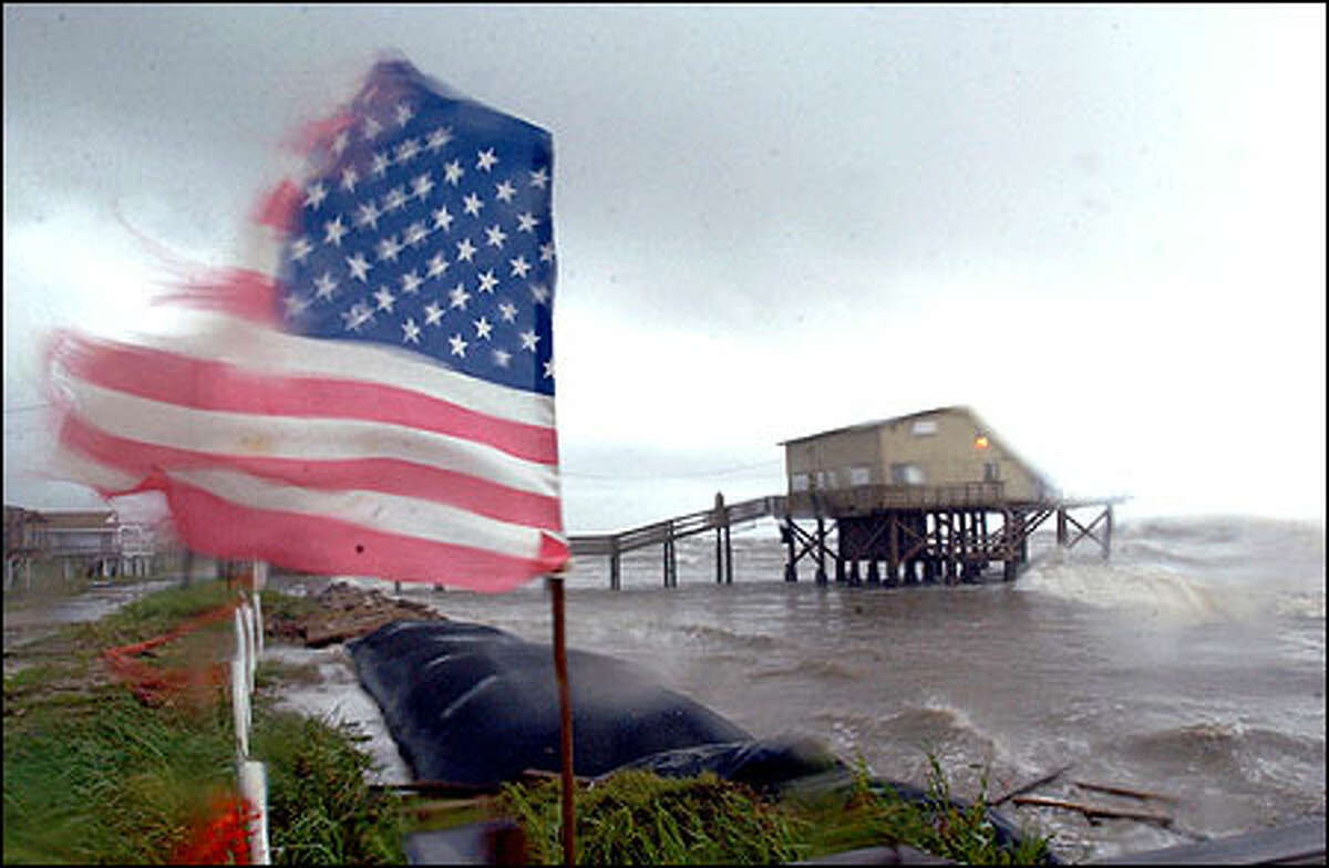 A U.S. flag in the neighborhood of Treasure Inland in San Luis Pass, Texas, is pulled apart from high winds blowing in from Tropical Storm Fay in the Gulf of Mexico Friday, Sept. 6, 2002. Although the storm had not reached land, a handful of school districts were closed and evacuations were recommended for some Galveston-area residents.