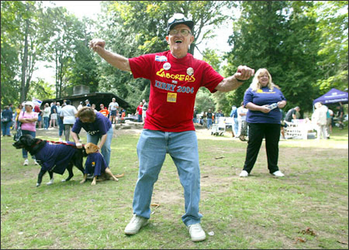 Retired laborer Robert Poli, 81, of Renton dances at the King County Labor Council's traditional Labor Day Picnic at Woodland Park in Seattle. Political candidates, including Democratic gubernatorial rivals Christine Gregoire and Ron Sims, posed for photographs and talked about their ideas yesterday.